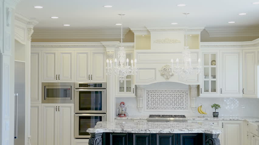 Luxurious white kitchen in a new home with a marble table #1010314079
