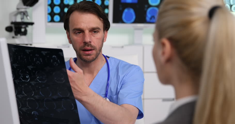 Medical Doctor Man Work Talk to a Patient Woman Hold Brain Mri in Hospital Room | Shutterstock HD Video #1010331041
