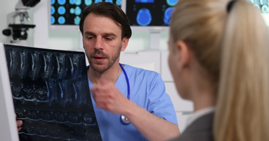 Medical Doctor Man Give Bad News of Spine Mri to Patient Woman in Hospital Room | Shutterstock HD Video #1010342078