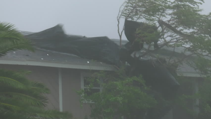 Rockport, TX/US - August 26, 2017 [Major Hurricane Harvey making landfall in Rockport, Texas. Hurricane winds, storm surge flooding along the coastal homes. Roof damage in strong winds.]
