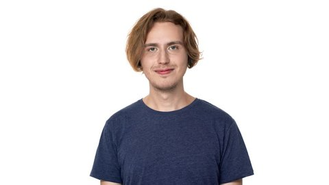 Portrait of friendly pleased man in casual t-shirt grinning and showing ok symbol with fingers, isolated over white background. Concept of emotions