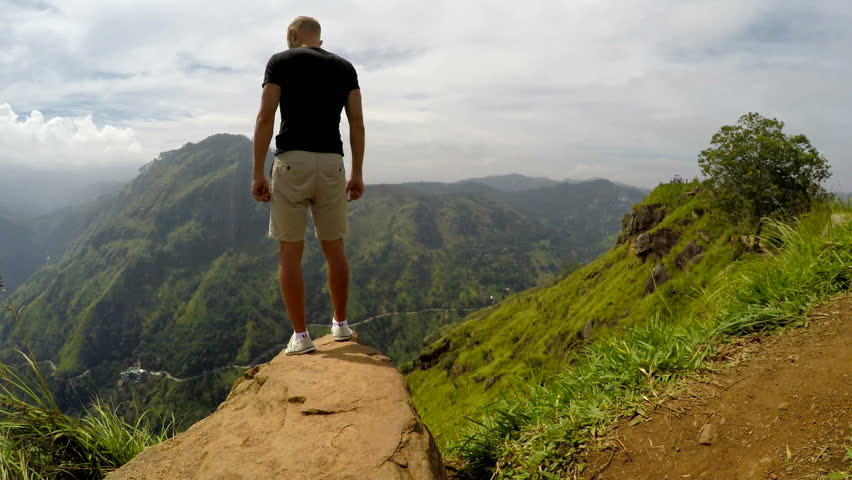 Traveler man enjoy mountains landscape. Travel concept vacations hiking in mountains,  Little Adam`s Peak, Ella, Sri Lanka