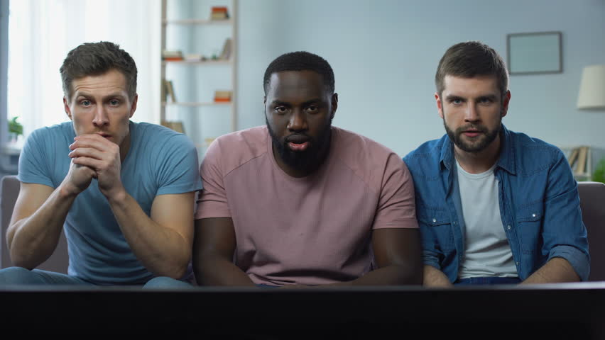 Three men watching football competition on big screen cheering best soccer team | Shutterstock HD Video #1010379113