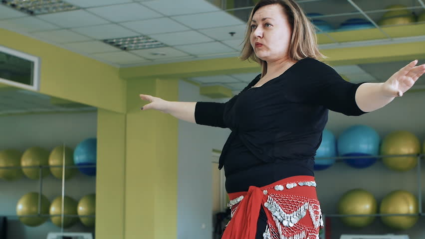 woman with excess weight training dance, overweight