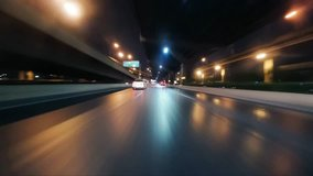Time-lapse moving forward of road in city  with bridge at night, thailand.