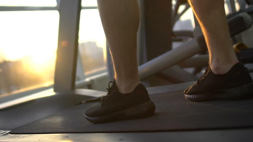Sportsman running on treadmill, acceleration, progress, attainment of life goal #1010396024