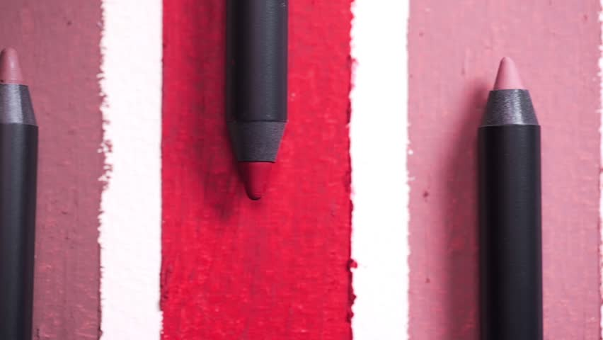 Close up of lip pencils are arranged in shades, beauty goods for woman, nature professional cosmetics, beauty care, makeup tools