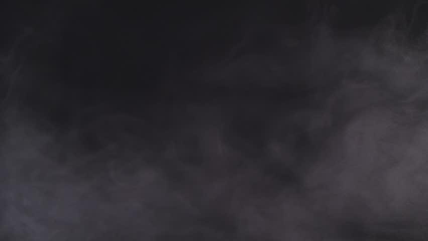 Slow moving smoke on black background   Shutterstock HD Video #1010403374