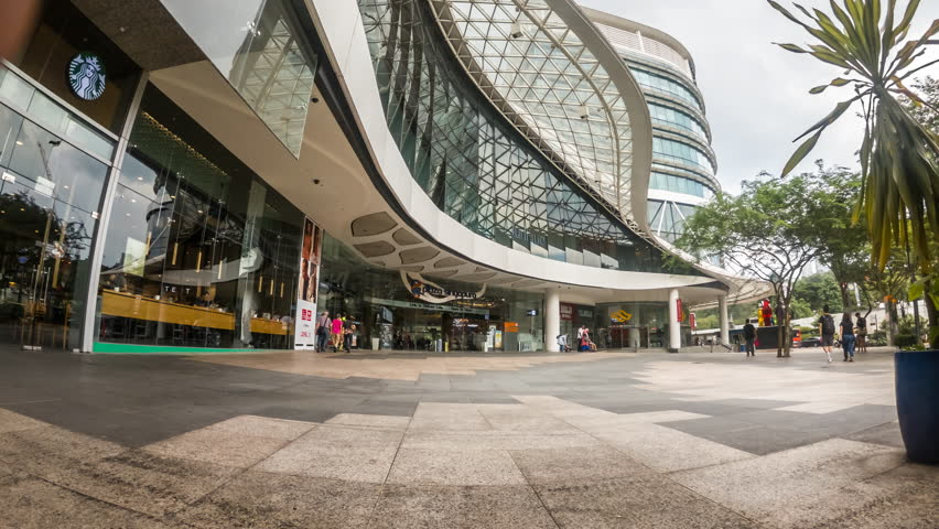 SINGAPORE 13 APR 2018: Timelapse video of Plaza Singapora Mall Entrance at Singapore City with cummuters.