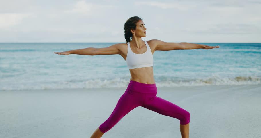 Beautiful young woman practicing yoga at sunrise   Shutterstock HD Video #1010416220