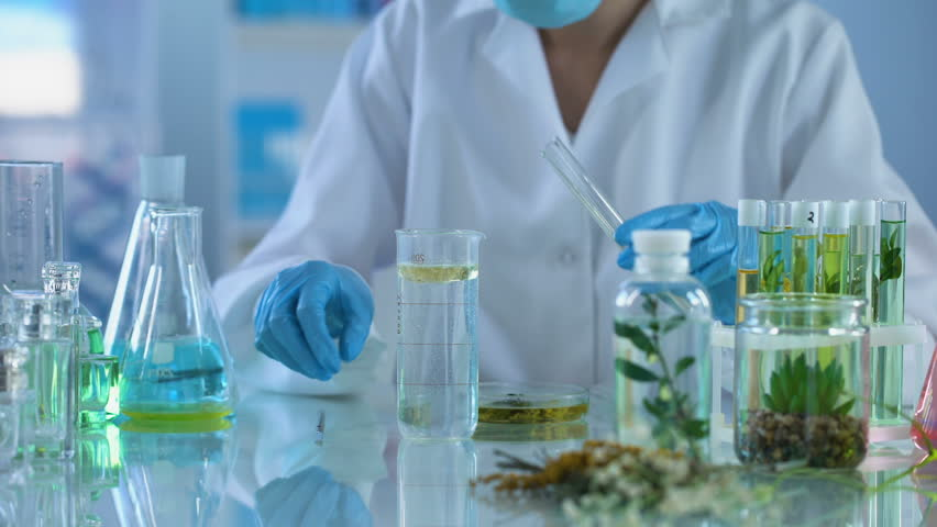 Female chemist pouring cosmetic oil in test liquid, body care production, aroma Royalty-Free Stock Footage #1010430572