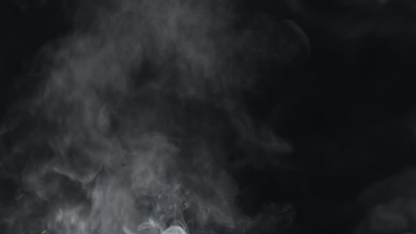 Slow motion vapor steam rising over black background | Shutterstock HD Video #1010431331