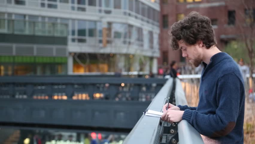 New york, New york,Usa. September 2th, 2016: New York City High Line night in New York City. young guy draws in pencil