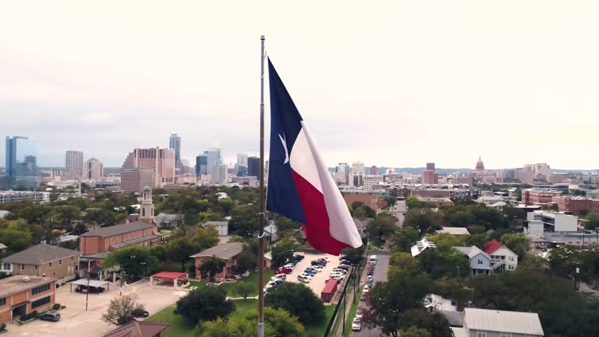 4K Texas Flag Orbiting Aerial at Sunset Austin