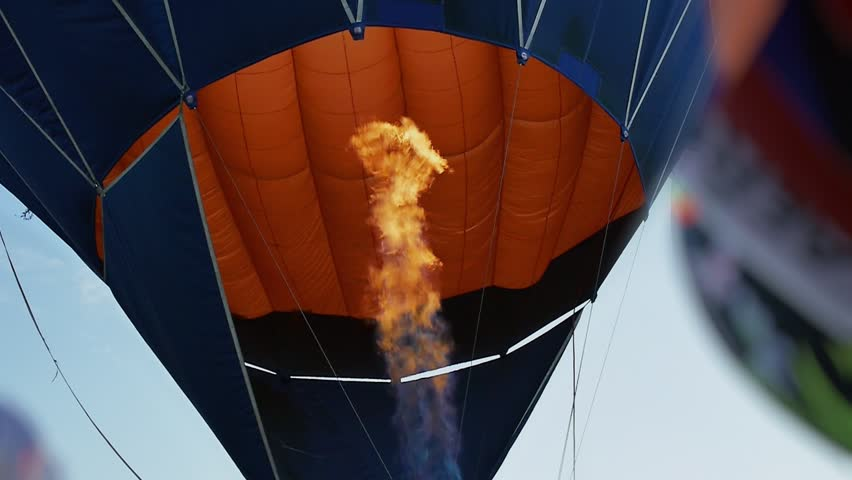 Fire from burner inflates hot air balloon. Flame tongue.