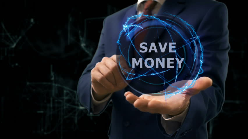 Businessman shows concept hologram Save money on his hand. Man in business suit with future technology screen and modern cosmic background Royalty-Free Stock Footage #1010470145