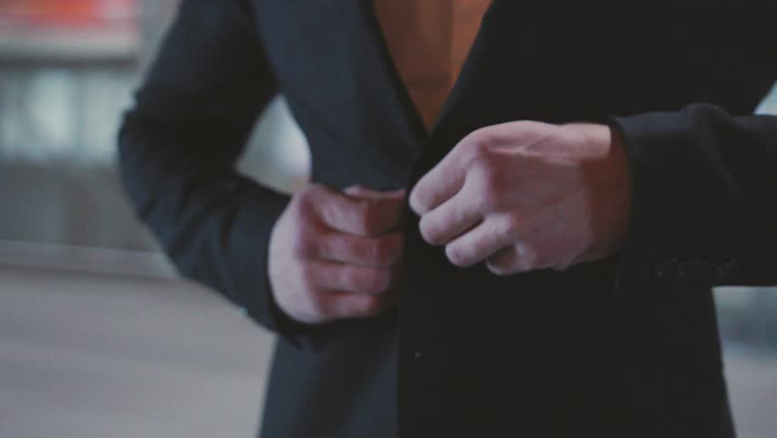 Close up hand stylish man in a suit fastening buttons on his jacket preparing to go out boss businessman money clothes success fingers gentleman slow motion accessory expensive leader dressing