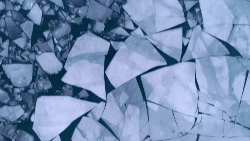 Aerial view of cracked ice floes. Global warming, climate change winter background Royalty-Free Stock Footage #1010483771