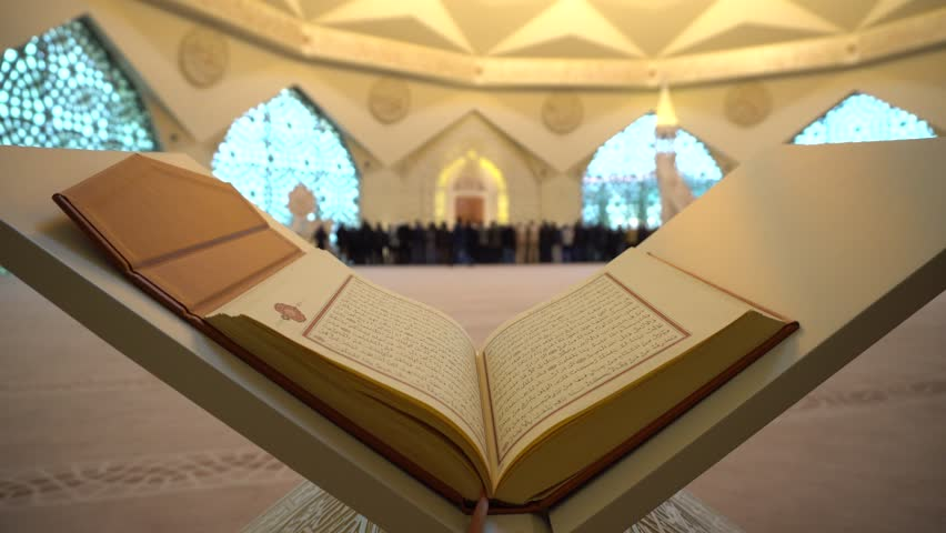 Quran or Koran - holy book and Muslim People praying in Mosque with sound  ISTANBUL, TURKEY - MARCH 2018   Shutterstock HD Video #1010489993