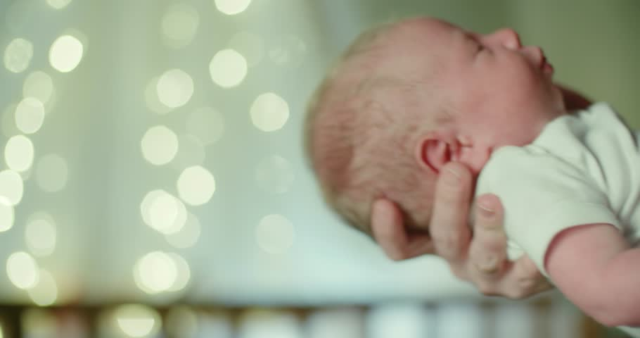 4k close-up, the newborn European in the mother's hands is laying to sleep4k close-up, the newborn European in the mother's hands is laying to sleep Royalty-Free Stock Footage #1010501717