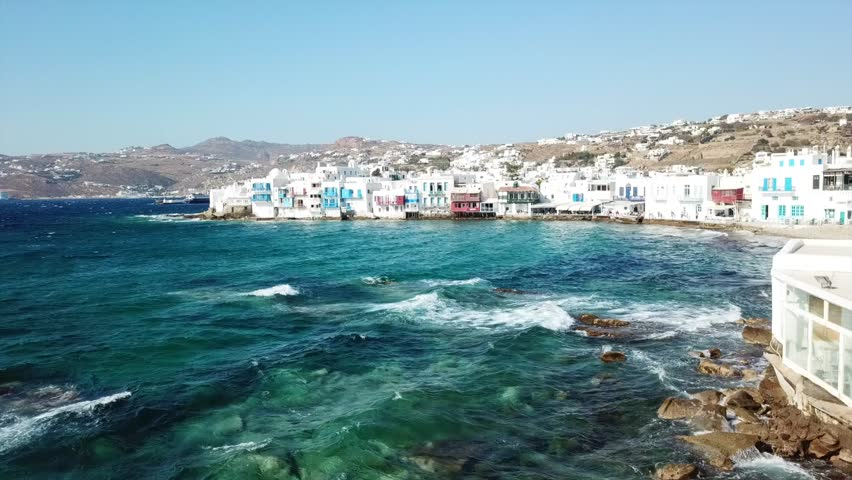 Aerial drone bird's eye view video of iconic little Venice in chora of Mykonos island, Cyclades, Greece