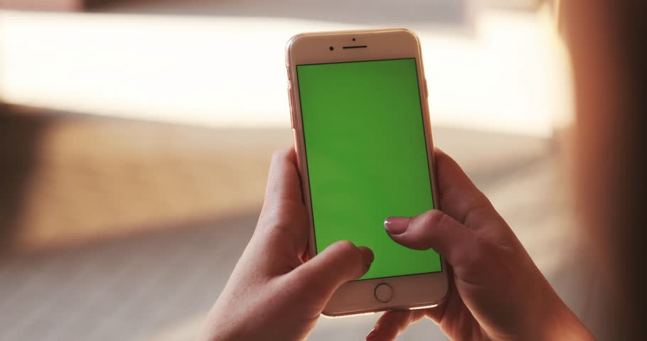 NEW YORK - April 5, 2018:Close up hands woman holding use white phone green screen scrolling pages swiping surfing internet technology smartphone message mobile phone sunlight | Shutterstock HD Video #1010521208