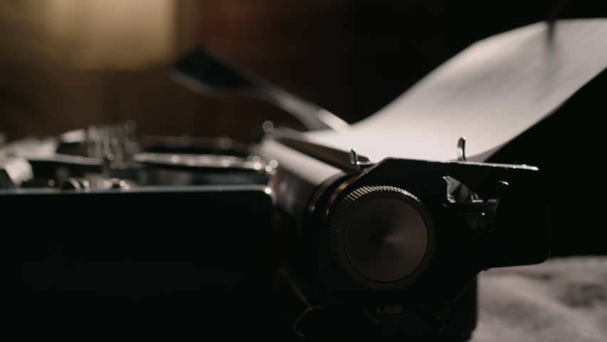 Carriage return knob pushing in and out of focus while typing on a vintage typewriter   Shutterstock HD Video #1010532698