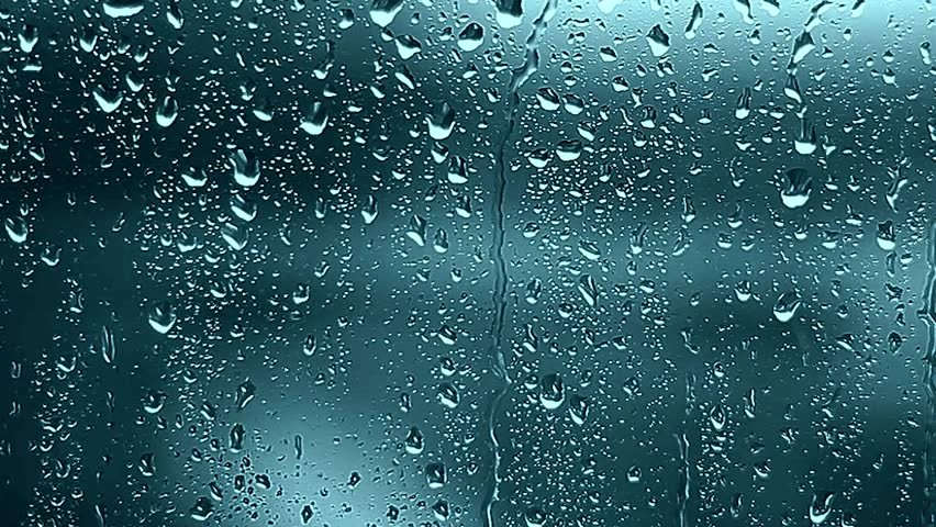 Close-up of water droplets on glass, Rain Rain, Go Away. Large rain drops strike a window pane during a summer shower. 4K. #1010547092