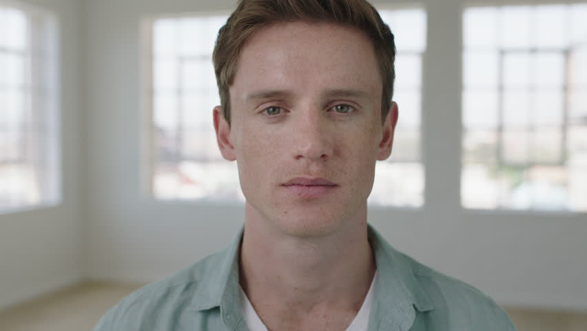 Slow motion portrait of young caucasian man smiling happy in apartment enjoying successful lifestyle move attractive independent male close up | Shutterstock HD Video #1010551163
