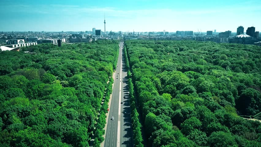 Aerial view of Berlin involving the Reichstag building, the Brandenburg Gate and the TV Tower, the most popular landmarks of the city