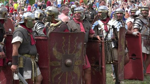 HECHINGEN, STEIN/GERMANY – August 28, 2016: Roman festival at the Roman estate in Hechingen,  Roman legionaries during the reenactment a battle against the Celts