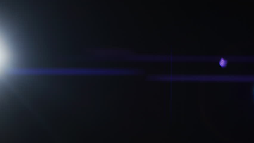 Real Lens Flare that is Easy to Use in Blend / Overlay Modes. Ascending White Light Makes Colorful Anamorphic Reflection on Screen. Light Transition, Prism Effect, Light Leaks. Shot on RED EPIC-W 8K | Shutterstock HD Video #1010600747