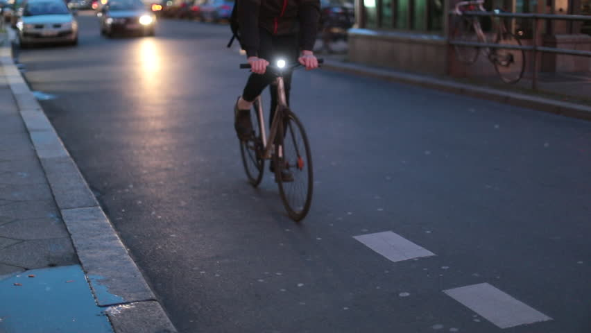City urban ciclist commuter passing camera in 120fps slow-motion close-up | Shutterstock HD Video #1010608067