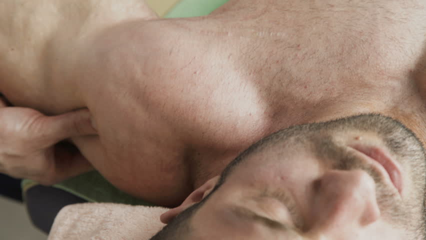 Close up view of massaging triceps of handsome athlete. 4K. | Shutterstock HD Video #1010630144