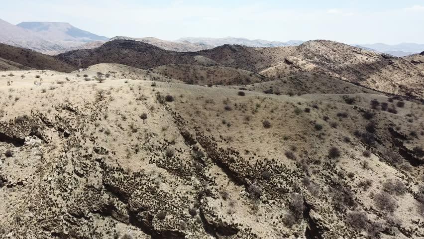 Establishing shot flying over African desert  | Shutterstock HD Video #1010631062