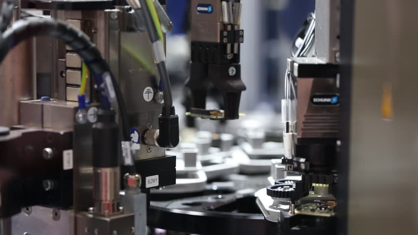 Hannover, Germany - April, 2018: Schunk assembly electronics line on Messe fair in Hannover, Germany | Shutterstock HD Video #1010700983