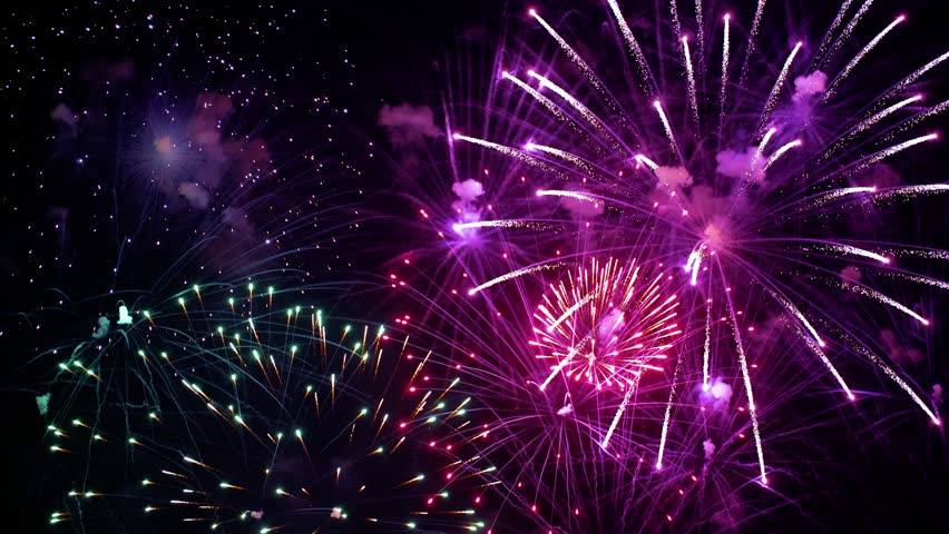 Colorful fireworks exploding in the night sky. Celebrations and events in bright colors. | Shutterstock HD Video #1010702081