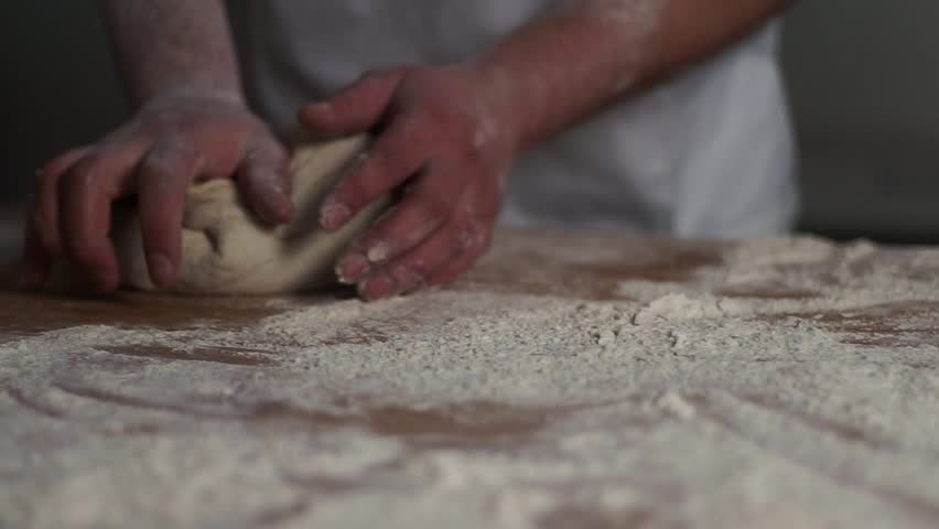 Workers rolling yeast balls into shape #1010702894