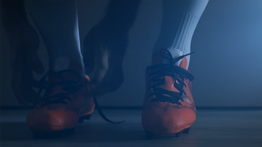 Soccer football player put on his shoes. Slow Motion.  | Shutterstock HD Video #1010713949