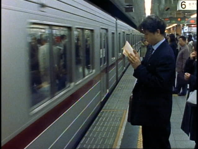 JAPAN, 1999, The Tokyo Subway, the train pulls out of the station, medium wide shot