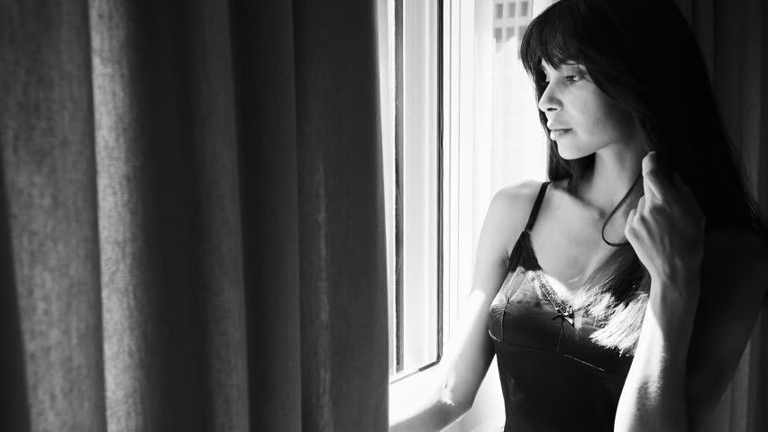 Sensual woman in lingerie looking out of window   Shutterstock HD Video #1010739494