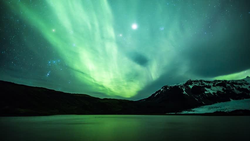 4K Aurora Borealis over a glacier lagoon lake Royalty-Free Stock Footage #1010746067