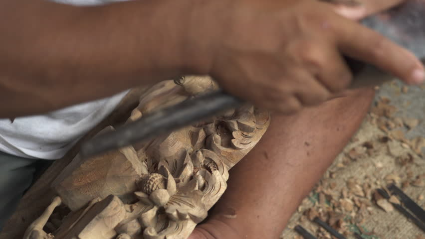 Asian wood carver working. Wood carving workshop Bali - October 2017: Sukawati, Bali, Indonesia | Shutterstock HD Video #1010747426