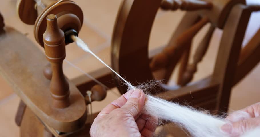 Senior woman operating weaving machine in the workshop 4K 4k | Shutterstock HD Video #1010759447