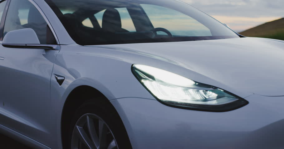 CALIFORNIA, USA - CIRCA APRIL 2018: The much anticipated Tesla Model 3 electric vehicle at sunset.   Shutterstock HD Video #1010765483
