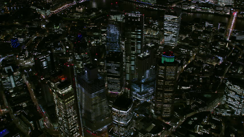 Aerial view at night London financial district street lights illuminated modern commercial skyscrapers Gherkin Walkie Talkie England UK RED WEAPON | Shutterstock HD Video #1010794604