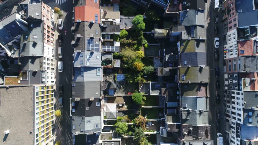Aerial top down view flight over Antwerp neighborhood first showing church then showing several residential and office buildings footage taken during beautiful summer day 4k high resolution quality