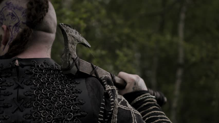 Cinematic Viking Warrior Ready For Battle, With Axe And Shield, Strong. A Variety Of 4K Camera Angles Available. Filmed In Flint, Wales Where Vikings Did Visit Historically.