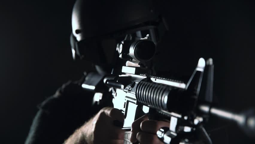 Spec ops police officer SWAT in black uniform studio #1010808524