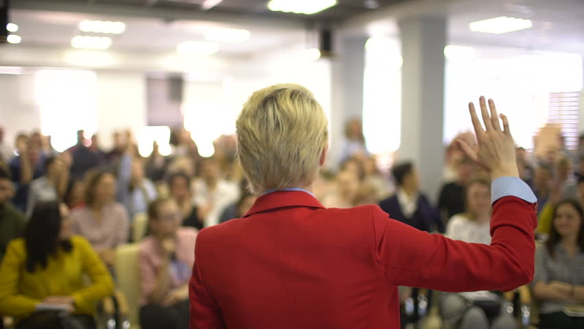 Person says about management for successful to college students indoors. Professional economy Speaker seminar business team teamwork conference coach businesswoman training audience students studying  Royalty-Free Stock Footage #1010812154